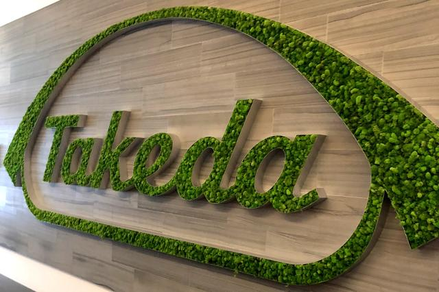 FILE PHOTO: A Takeda logo is seen in its research hub in Cambridge, Massachusetts, U.S., November 26, 2018.  REUTERS/Julie Steenhuysen/File Photo