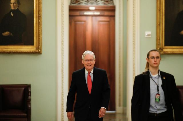U.S. Senate Majority Leader Mitch McConnell (R-KY) enters the Senate Chamber Floor after Congress agreed to a multi-trillion dollar economic stimulus package created in response to the economic fallout from the COVID-19 Coronavirus, on Capitol Hill in Washington, U.S., March 25, 2020. REUTERS/Tom Brenner
