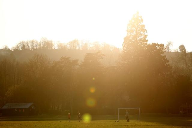 General view as people play football in a park, as the spread of the coronavirus disease (COVID-19) continues, High Wycombe, Britain, March 26, 2020. REUTERS/Eddie Keogh