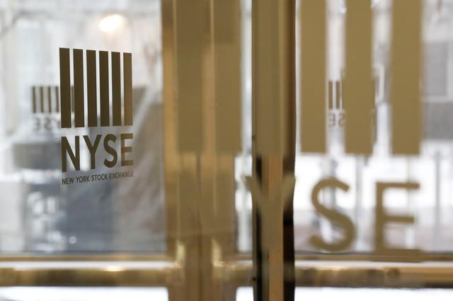 The logo of theNewYorkStockExchange(NYSE) is seen on the door inNewYork, U.S., March 18, 2020. REUTERS/Lucas Jackson