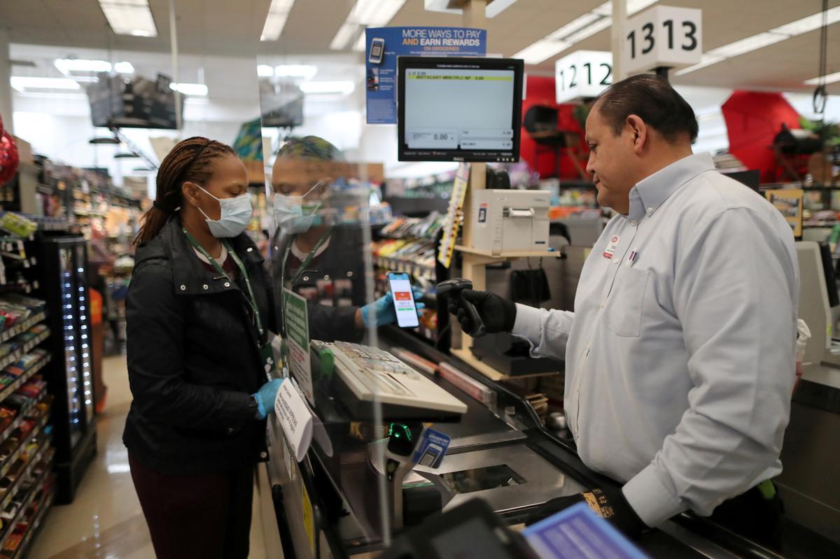 U.S. grocers add plexiglass sneeze guards to protect cashiers from coronavirus