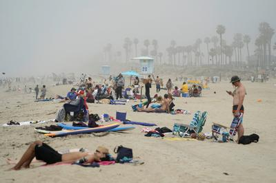 People flock to beaches despite coronavirus concerns