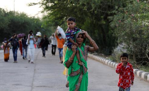 India's migrants walk home amid coronavirus lockdown
