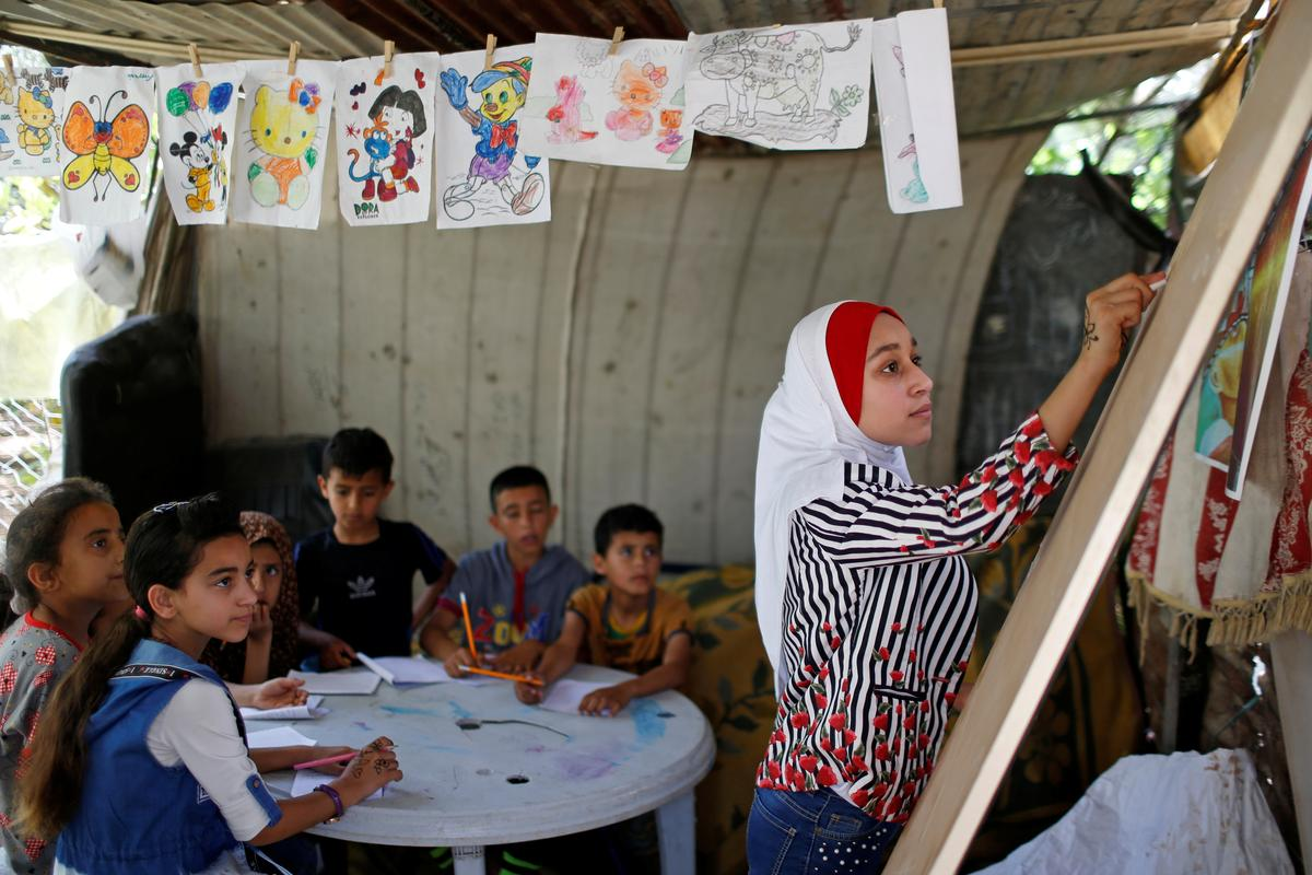 Gaza girl, 13, teaches neighbourhood children during school closure