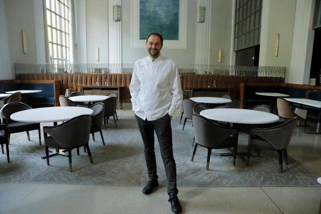 Chef and owner Daniel Humm poses for a portrait in the shuttered dining room of Michelin starred restaurant Eleven Madison Park as the outbreak of the coronavirus disease (COVID19) continues in the Manhattan borough of New York, U.S., May 20, 2020.  Picture taken May 20, 2020. REUTERS/Lucas Jackson