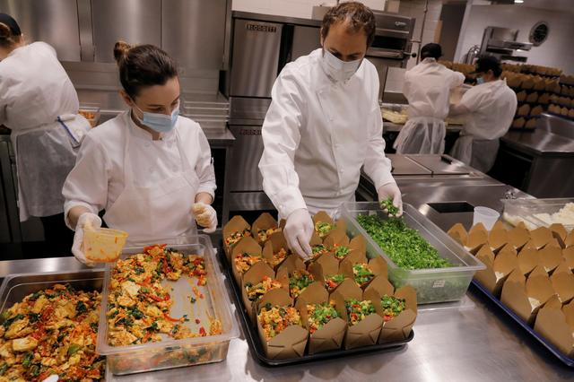 Chef and owner Daniel Humm works to fill to-go boxes of food to donate in the kitchen of Michelin starred restaurant Eleven Madison Park as the outbreak of the coronavirus disease (COVID19) continues in the Manhattan borough of New York, U.S., May 20, 2020.  Picture taken May 20, 2020. REUTERS/Lucas Jackson