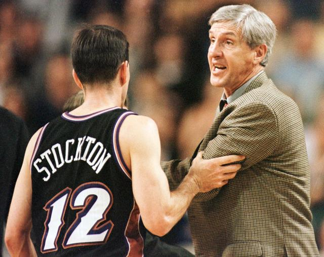 FILE PHOTO: Utah Jazz head coach Jerry Sloan (R) is restrained by John Stockton (12) during the final minute of play after Sloan started to argue with a referee their NBA playoff game against the Seattle Supersonics at Key Arena in Seattle, May 3. Seatlle beat Utah 104-93. APB/SV