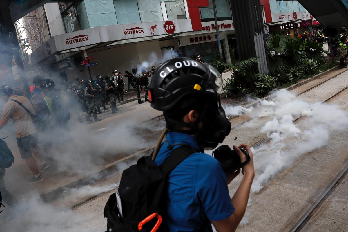 Hong Kong police fire tear gas as thousands protest security law 67