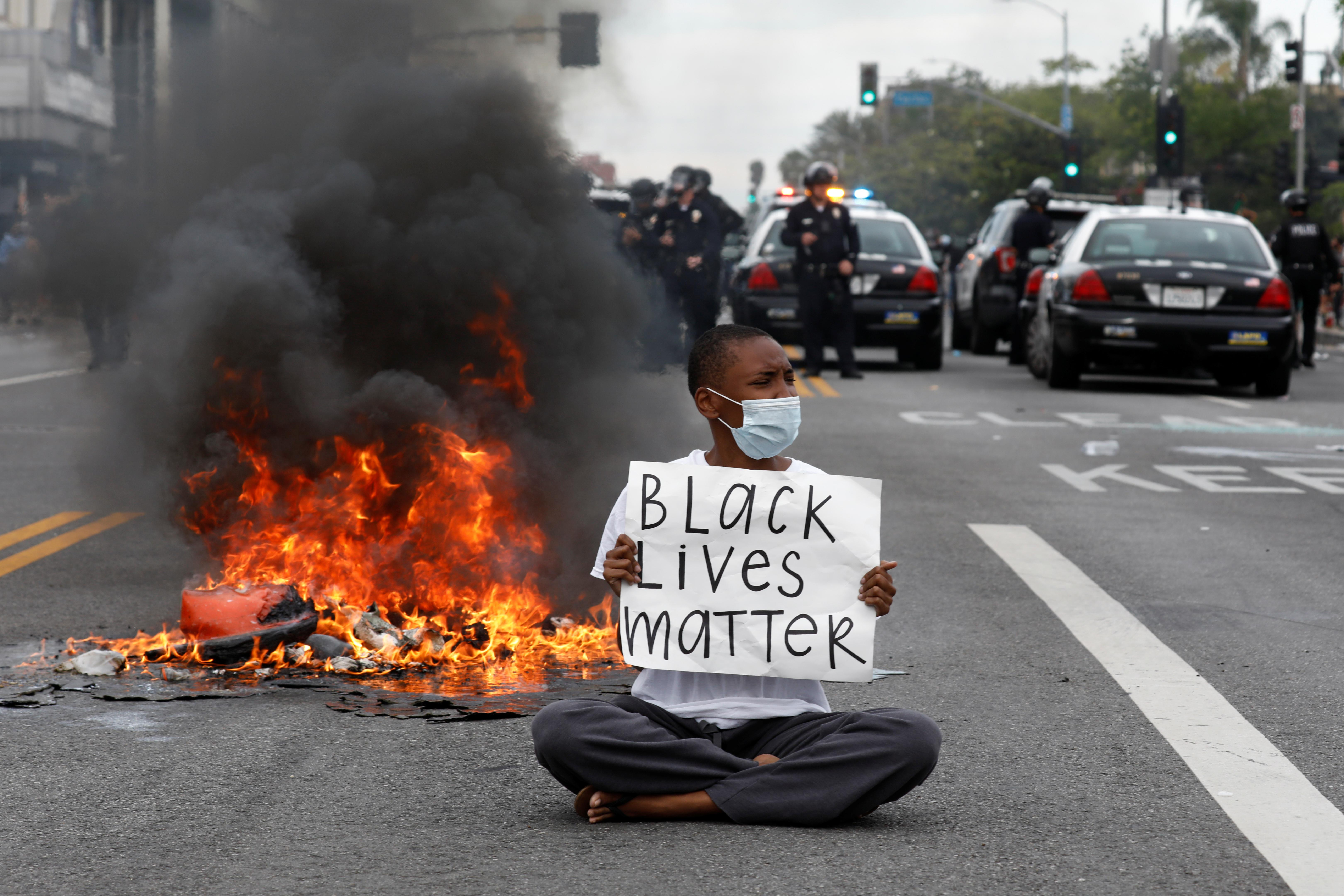 'I can't breathe' protests heat up as curfews imposed in several U.S. cities