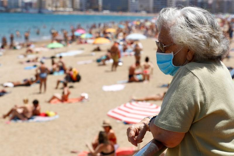 Beaches reopen as Spain courts foreign tourists with health ...