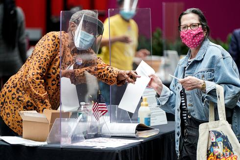 Eight states cast ballots on biggest voting day since pandemic