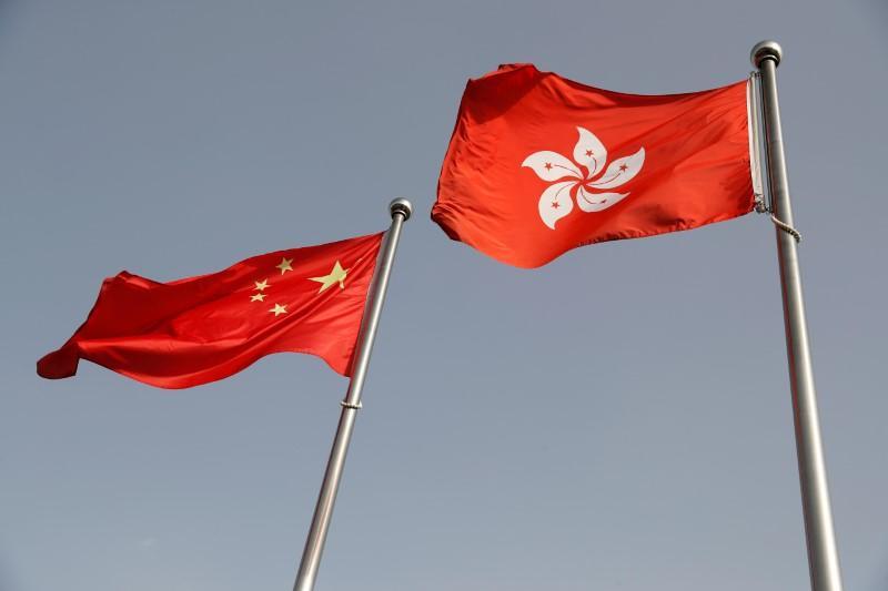 Protest disrupts Hong Kong legislative debate over China national anthem bill