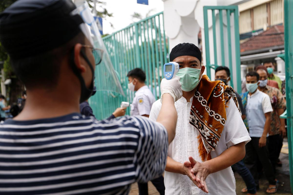 Indonesia reports 703 new coronavirus infections, 49 new deaths: official