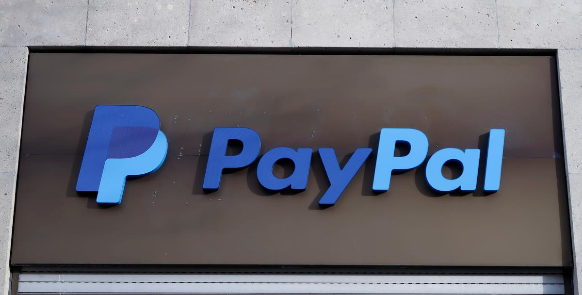 FILE PHOTO: The PayPal logo is seen at an office building in Berlin, Germany, March 5, 2019. REUTERS/Fabrizio Bensch