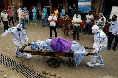 Cities across India extend lockdowns as coronavirus cases surge