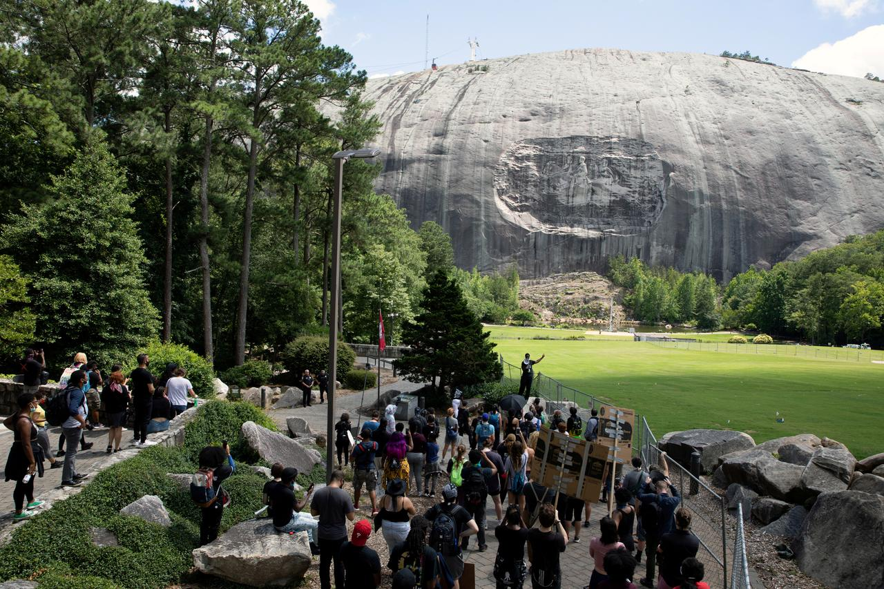 Armed Black Protesters March Through Stone Mountain Park in Georgia Calling for Removal of Confederate Rock Carving
