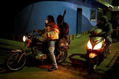 Armed civilians enforce coronavirus curfew in Guatemala