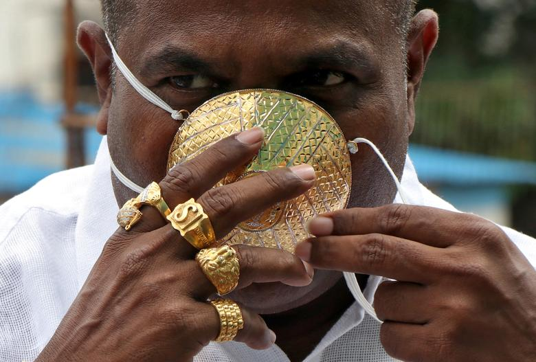 Shankar Kurhade, 48, wears his face mask made out of gold as he poses for a photograph in Pune, India, July 4, <span dir=