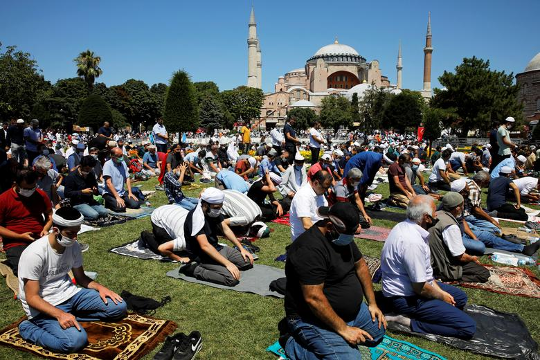 Muslims attend Friday prayers outside Hagia Sophia Grand Mosque, for the first time after it was once again declared a mosque after <span dir=