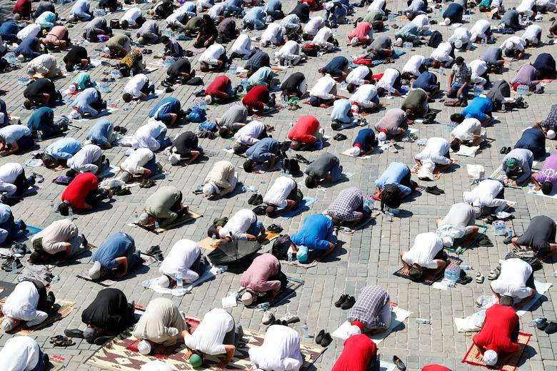 Muslims attend Friday prayers outside Hagia Sophia Grand Mosque, July <span dir=