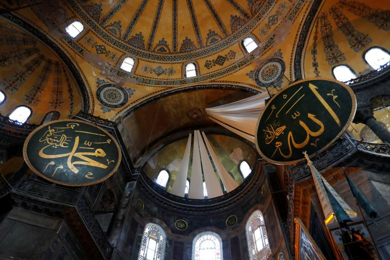 Curtains covering Christian frescoes are pictured at Hagia Sophia Grand Mosque after Friday prayers, July <span dir=