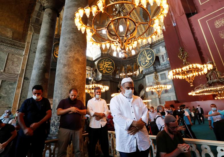 People pray as they visit Hagia Sophia Grand Mosque after Friday prayers, July <span dir=