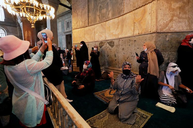 Muslim women visit Hagia Sophia Grand Mosque after Friday prayers, July <span dir=
