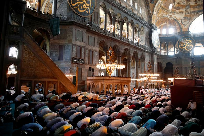 Worshippers attend afternoon prayers and visit Hagia Sophia Grand Mosque in Istanbul, Turkey, July 24, <span dir=