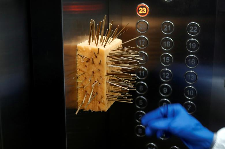 A sponge with toothpicks is seen inside an elevator to prevent people from touching the buttons with their bare hands at a residential society in Mumbai, India, August 2, 2020. REUTERS/Francis Mascarenhas