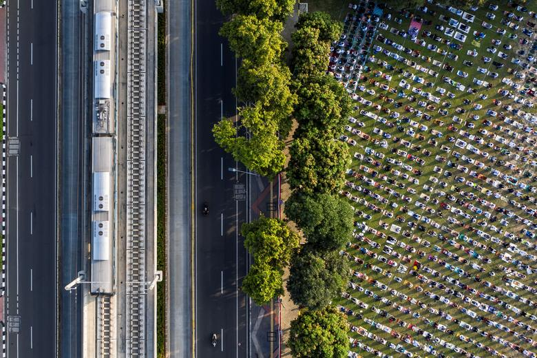 An aerial picture of Indonesian Muslims offering Eid al-Adha prayers at the Great Mosque of Al-Azhar in Jakarta, Indonesia, July 31, 2020. Antara Foto/Muhammad Adimaja/ via REUTERS