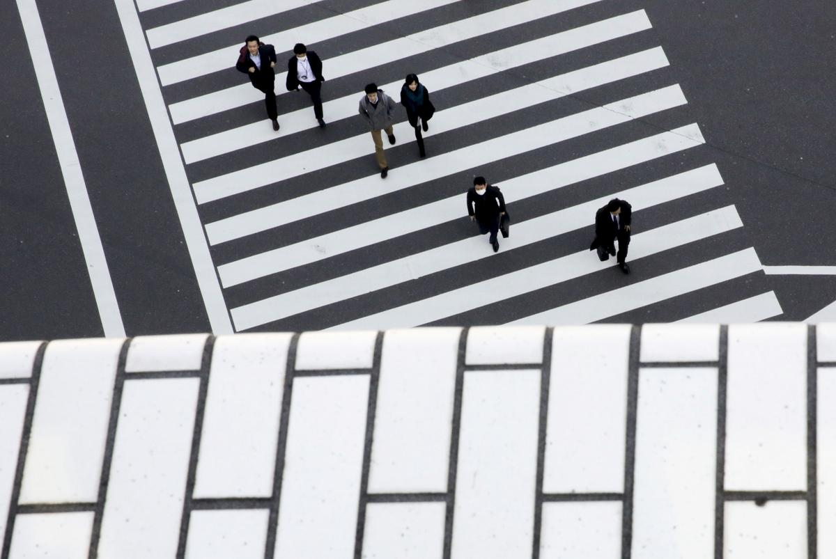 Japan's economy shrinks at record pace as pandemic wipes out 'Abenomics' gains – Reuters