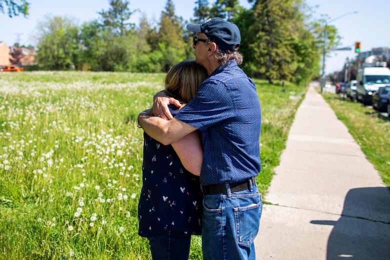 Diane Colangelo, who lost her mother Patricia Crump to coronavirus on May 6, is comforted by her husband John Colangelo at Orchard Villa Retirement Residence where several residents died, in Pickering, Ontario, Canada, May 26. REUTERS/Carlos Osorio
