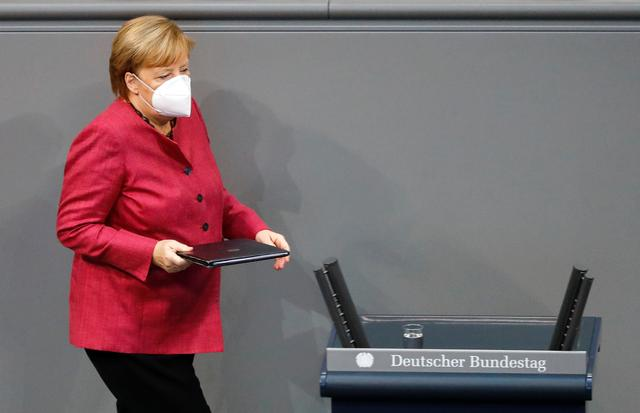 German Chancellor Angela Merkel wears a face mask as she attends a session of the German lower house of parliament Bundestag, as the spread of the coronavirus disease (COVID-19) continues in Berlin, Germany, October 29, 2020. REUTERS/Fabrizio Bensch