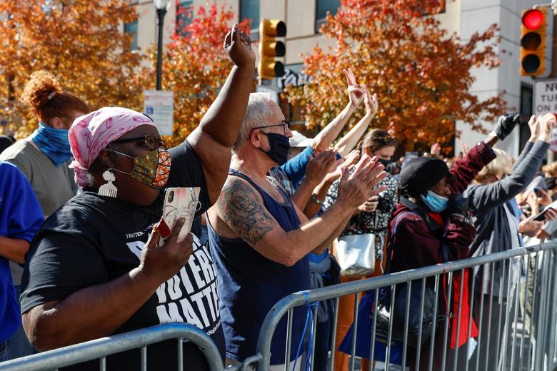 People react as media announce that Joe Biden has won the election in Philadelphia, November 7. REUTERS/Rachel Wisniewski