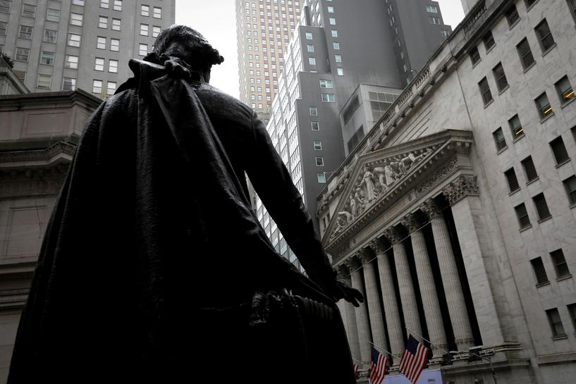 FILE PHOTO: A statue of George Washington stands as Federal Hall across Wall Street from the New York Stock Exchange in Manhattan in New York City, New York, U.S., October 26, 2020. REUTERS/Mike Segar