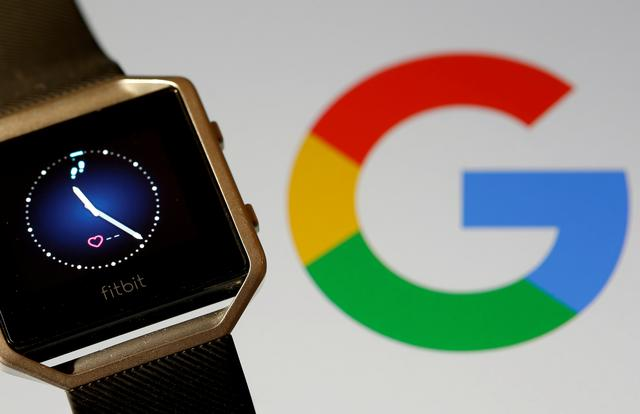 FILE PHOTO: Fitbit Blaze watch is seen in front of a displayed Google logo in this illustration picture taken, November 8, 2019. REUTERS/Dado Ruvic/File Photo/File Photo