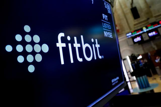FILE PHOTO: The logo for wearable device maker Fitbit Inc. is displayed on a screen on the floor of the New York Stock Exchange (NYSE) as the company begins public trading in New York, U.S., October 28, 2019. REUTERS/Brendan McDermid/File Photo
