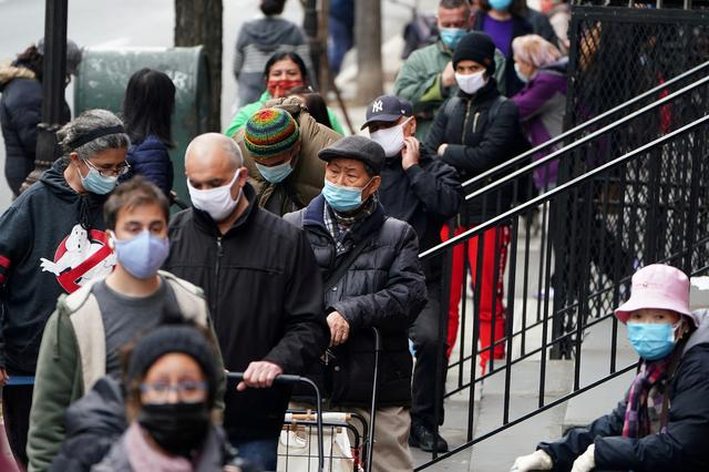 FILE PHOTO: People wait in line at the St. Clements Food Pantry for food during the coronavirus disease (COVID-19) pandemic in the Manhattan borough of New York City, New York, U.S., December 11, 2020. REUTERS/Carlo Allegri/File Photo/File Photo/File Photo