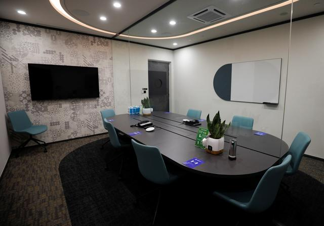 A view of a meeting room outfitted with airtight glass panels at short-stay facility Connect@Changi, a complex of hotel rooms and meeting halls near the airport which will welcome business ''bubble'' travellers from March, as part of the city-state's effort to resume international meetings and conferences amid the coronavirus disease (COVID-19) outbreak, in Singapore February 22, 2021. REUTERS/Edgar Su