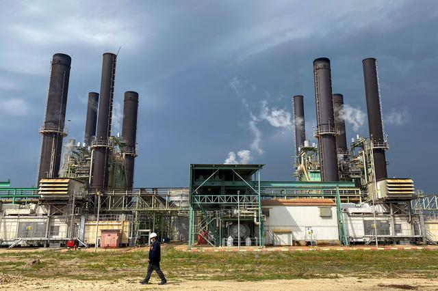 A member of the staff walks at Gaza's lone power plant, in the central Gaza Strip February 23, 2021. REUTERS/Mohammed Salem