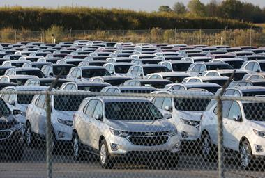 FILE PHOTO: Chevrolet Equinox SUVs are parked awaiting shipment near the...