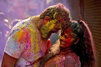 Revelers daub in the colors of Holi