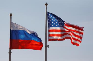National flags of Russia and U.S. fly at Vnukovo International Airport in...